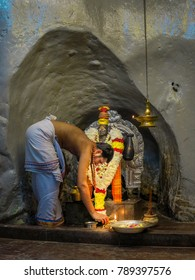 Gombak, Selangor, Malaysia - 10/09/2016: A religious devotee makes an offereing to a Hindu deity at the Batu Caves Ramanyana Display in Gombak, Selangor, Malaysia.