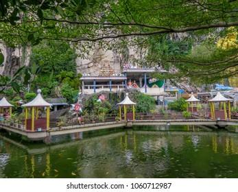Gombak, Selangor, Malaysia - 10/9/2016: Garden, shrine and pond just outside Batu Caves.