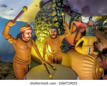 Gombek, Selangor, Malaysia - 10/9/2016: Detail of a diorama of the life of Lord Rama shows two drummers entertaining him in the Ramayana Cave, part of the Batu Cave Complex.