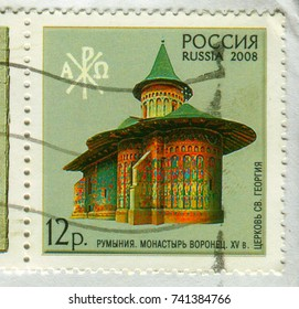 GOMEL, BELARUS, 13 OCTOBER 2017, Stamp printed in Russia shows image of The Voronet Monastery is a medieval monastery in the Romanian village of Voronet, circa 2008.