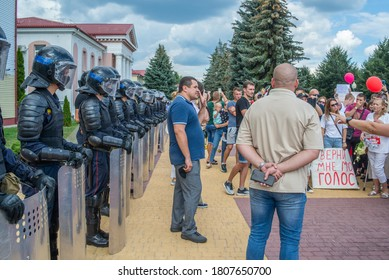 Gomel, Belarus, 16.08.20: Peaceful protests in Belarus. Presidential elections in Belarus 2020. Riot police with lowered shields in front of protesters