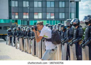 Gomel, Belarus, 16.08.20: Peaceful protests in Belarus. Presidential elections in Belarus 2020. Photographer takes pictures of protesters in front of riot police