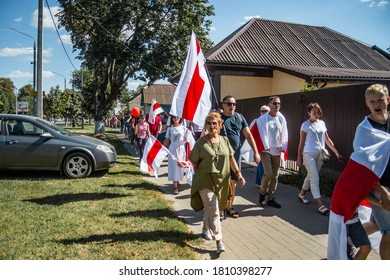 Gomel, Belarus, 23.08.20: Peaceful protests in Belarus. Presidential elections in Belarus 2020. Protesters with flags walking down the street