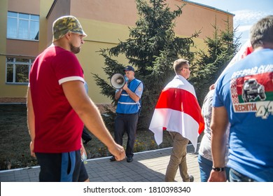 Gomel, Belarus, 23.08.20: Peaceful protests in Belarus. Presidential elections in Belarus 2020. Policeman with loudspeaker urges people to disperse