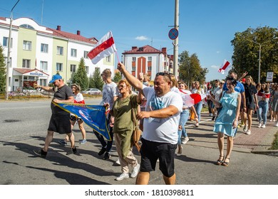 Gomel, Belarus, 23.08.20: Peaceful protests in Belarus. Presidential elections in Belarus 2020. Protesters with flags walk past the police building