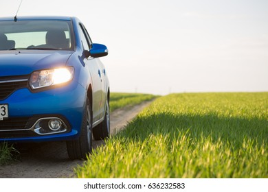 GOMEL, BELARUS - 6 May 2017: blue car Renault Logan parked in a field on a country road