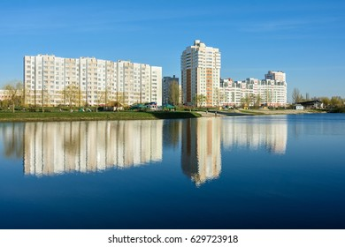 GOMEL, BELARUS - APRIL 09, 2017: Microdistrict Klenkovsky. New residential district in ecologically clean area of Gomel. A view of the lake and the houses along Makayonka street.
