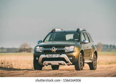 Gomel, Belarus - April 10, 2019: Green Car Renault Duster Or Dacia Duster Suv Parked On Field Country Road.