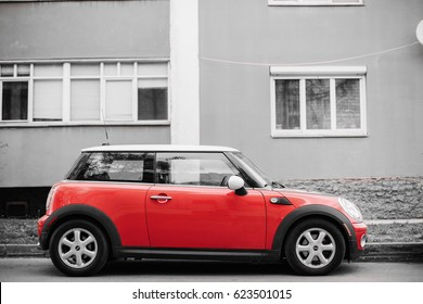 Gomel, Belarus - April 14, 2017: Red Color Car Mini Cooper Parked On Street Near Residential House. All Colors Except Red Are Reduced