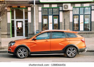 Gomel, Belarus - April 16, 2019: Orange Lada Vesta SW Cross Car Parked At Street. Side View