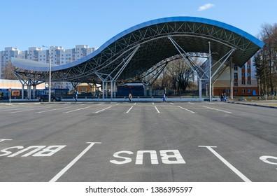 GOMEL, BELARUS - APRIL 2, 2019: Unknown people are walking down Golovatskogo street near Ice skating rink, Gomel, Belarus