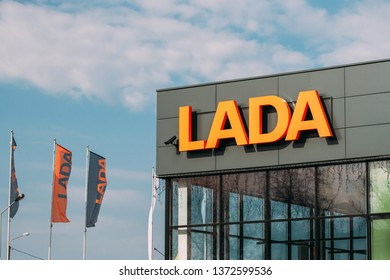 Gomel, Belarus - April 8, 2019: Close View Of Logotype Lada At Wall Of Store In Car Showroom. The Lada Is A Brand Of Cars Manufactured By Avtovaz, A Company Owned By The French Groupe Renault.