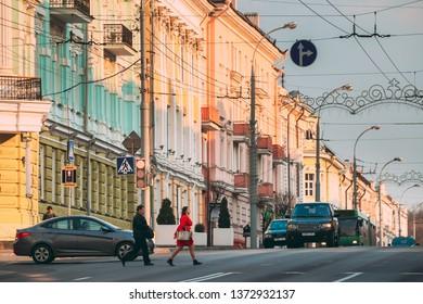 Gomel, Belarus - April 8, 2019: Traffic On Sovetskaya Street In Gomel, Belarus. Colorful Trolleybuses Moving On City Center.