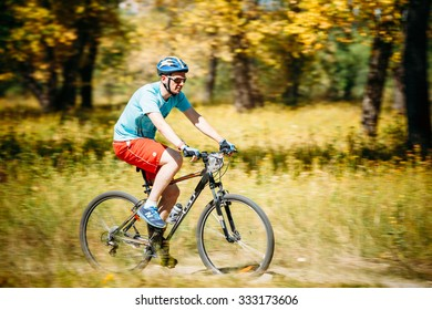 Gomel, Belarus - August 9, 2015: Mountain Bike cyclist riding track at sunny day, healthy lifestyle active athlete doing sport.