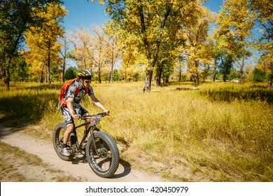 Gomel, Belarus - August 9, 2015: Mountain Bike With Fat Tires Cyclist Riding Track At Sunny Day, Healthy Lifestyle Active Athlete Doing Sport.