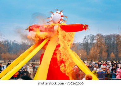 Gomel, Belarus. Burning Effigies Straw Maslenitsa In Fire On The Traditional National Holiday Dedicated To The Approach Of Spring - Slavic Celebration Shrovetide.
