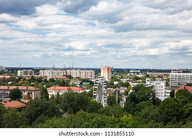 Gomel, Belarus. Cityscape And Architecture. Top Aerial View Of Ferris Wheel Among Green Trees Crowns And Old Soviet Residential And Administrative Buildings Of Central District.