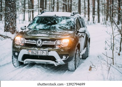 Gomel, Belarus - December 25, 2018: Renault Duster Suv Parked In Snowy Forest. Duster Produced Jointly By French Manufacturer Renault And Its Romanian Subsidiary Dacia Since 2010.