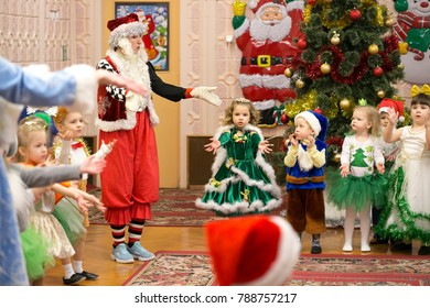 Gomel, Belarus - December 28, 2017: beautiful, funny, small children in festive costumes at the matinee. Children's holiday - New Year, Christmas