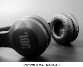 GOMEL, BELARUS - FEBRUARY 12, 2019: JBL wireless black headphones on a dark background.