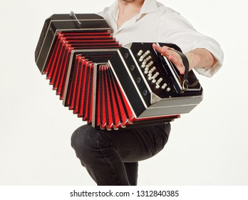 GOMEL, BELARUS - FEBRUARY 14, 2019: a bandoneon musical instrument in the hands of a musician.