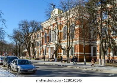 GOMEL, BELARUS - FEBRUARY 16, 2015: Unidentified people walk down street near Belorussian State University of Transport in Gomel, Belarus