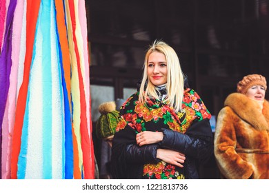 Gomel, Belarus - February 18, 2018: Beautiful young woman in Belarusian shawl at the Shrovetide fair in Gomel