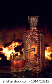 GOMEL, BELARUS - February 5, 2011: alcoholic products of the Gomel distillery on the background of the fireplace
