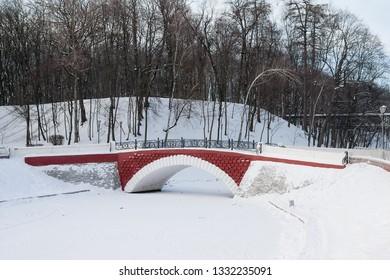 GOMEL, BELARUS - JANUARY 08, 2016: Ponds and bridges in city park in Christmas in Gomel, Belarus.