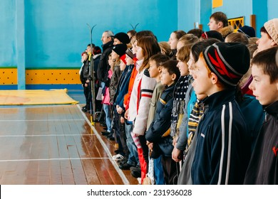 GOMEL, BELARUS - JANUARY 1, 2011: Unrecognizable Belarusian secondary school pupils lined up in the school gym before the winter ski competitions.
