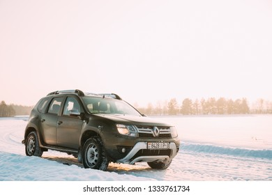 Gomel, Belarus - January 10, 2019: Car Renault Duster Or Dacia Duster Suv Parked On Winter Snowy Field At Sunset Dawn Sunrise.