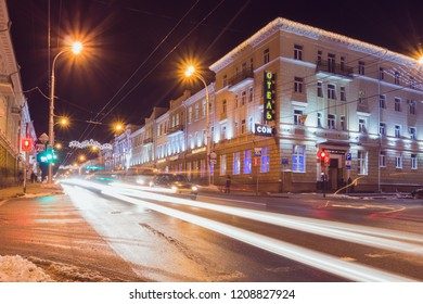 Gomel, Belarus - January 20, 2018: Night street of Gomel city with cars on the road at long exposure. Winter