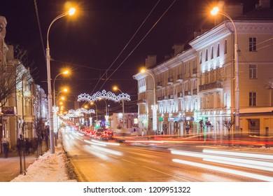 Gomel, Belarus - January 20, 2018: Traces of car headlights at night on the road of the city of Gomel Sovetskaya street
