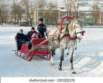 GOMEL, BELARUS - JANUARY 20, 2019: people ride in winter in a horse-drawn sleigh.