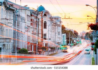 Gomel, Belarus - July 19, 2016: Evening Traffic On Sovetskaya street In Gomel, Belarus. Dramatic Sky With Warm Colors At Sunset.