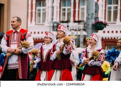 Gomel, Belarus - July 3, 2018: People man and women in national traditional Belarusian folk Ethnic costumes participating in the parade dedicated to the Independence Day