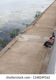 Gomel, Belarus - July 30 Fishermen on the embankment of the river Sozh in Gomel in the early morning