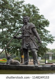Gomel, Belarus - July 30 Monument to the first settler in the city of Gomel. A man swims with a lynx on a boat