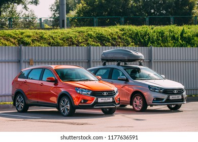 Gomel, Belarus - July31, 2018: Orange Lada Vesta SW Cross And Gray Vesta SW Car Parked At Street.