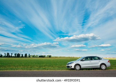 Gomel, Belarus - June 13, 2016: View from the Volkswagen Vento Polo on the background of a beautiful sky with clouds and green field