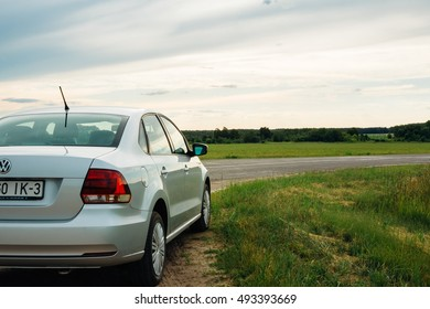 Gomel, Belarus - June 13, 2016: Volkswagen Polo Vento standing on the side of the road on the background fields and forests