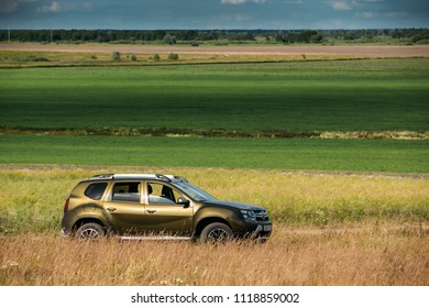 Gomel, Belarus - June 13, 2018: Renault Duster or Dacia Duster SUV in summer meadow landscape. Duster produced jointly by French manufacturer Renault and its Romanian subsidiary Dacia since 2010.