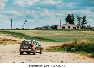 Gomel, Belarus - June 13, 2018: Dirty Car Renault Duster or Dacia Duster SUV in countryside landscape. Duster produced jointly by French manufacturer Renault and its Romanian subsidiary Dacia