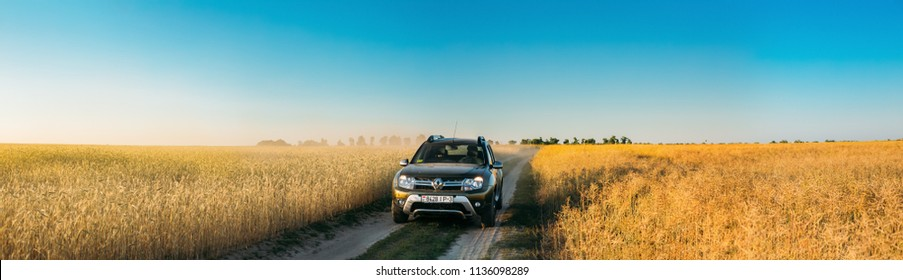 Gomel, Belarus - June 21, 2018: Renault Duster or Dacia Duster SUV in summer wheat field countryside landscape. Duster produced jointly by French manufacturer Renault and its Romanian subsidiary Dacia