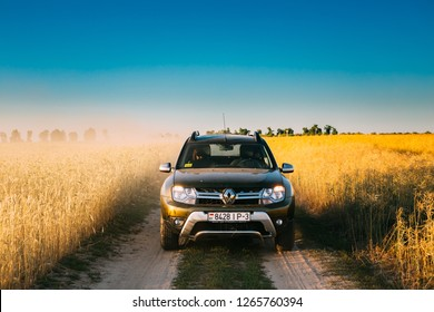 Gomel, Belarus - June 21, 2018: Car Renault Duster or Dacia Duster SUV in country road through summer wheat field. Duster produced jointly by French manufacturer Renault and its subsidiary Dacia
