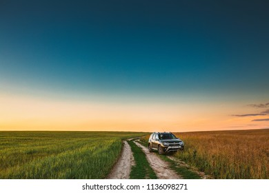 Gomel, Belarus - June 24, 2018: Renault Duster or Dacia Duster SUV in summer wheat field countryside landscape. Duster produced jointly by French manufacturer Renault and its Romanian subsidiary Dacia