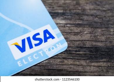 GOMEL, BELARUS - June 30, 2018. Visa logos on credit cards. Wood background