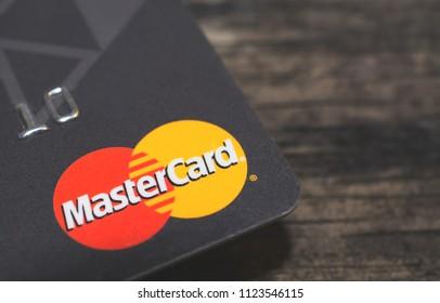 GOMEL, BELARUS - June 30, 2018. Mastercard logos on credit cards. Wood background