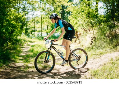 GOMEL, BELARUS - JUNE 7, 2015: Mountain Bike cyclist riding track at sunny day, healthy lifestyle active athlete doing sport