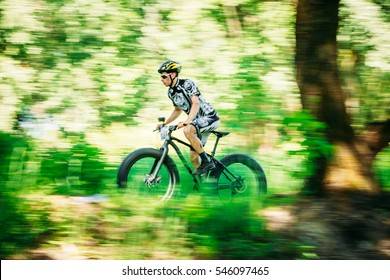 GOMEL, BELARUS - JUNE 7, 2015: Mountain Bike cyclist riding track on fat tire bike at sunny day